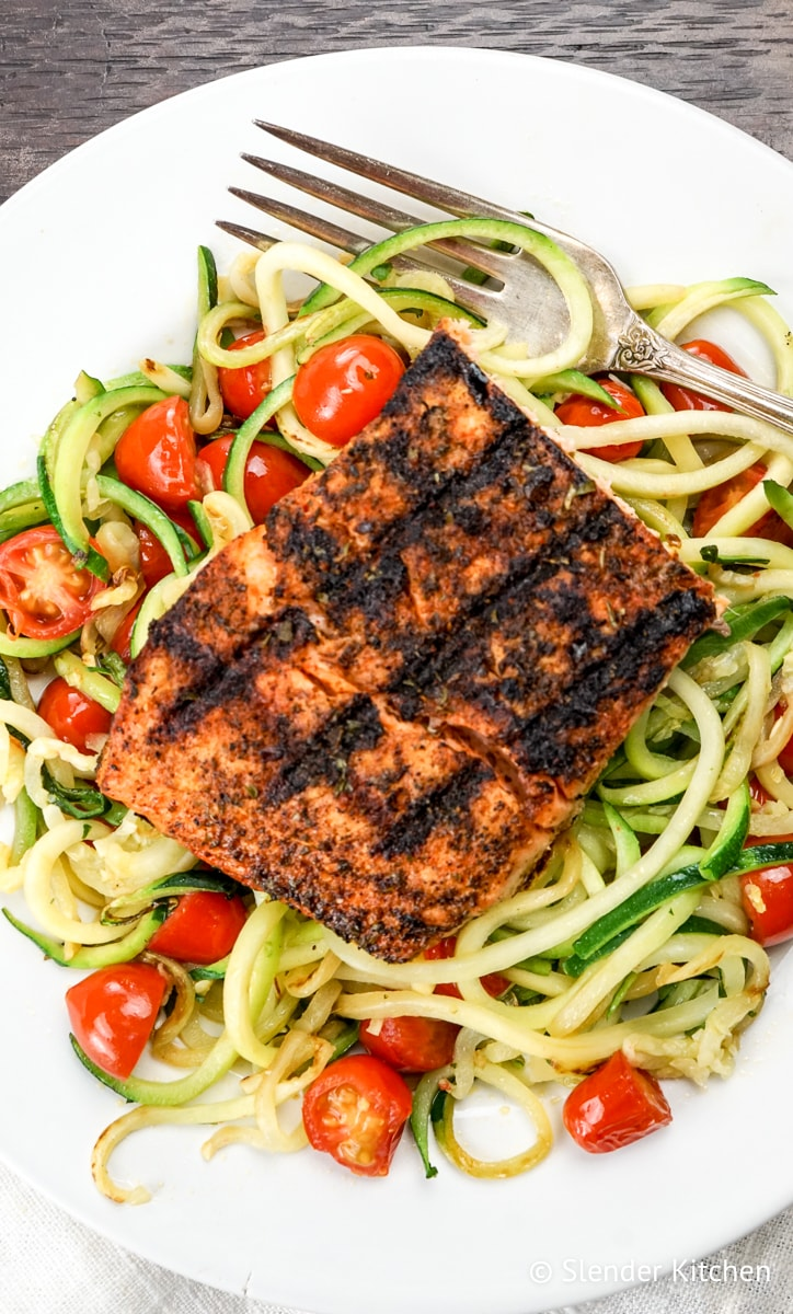 Blackened Salmon with Garlic Zucchini Noodles with an antique fork.