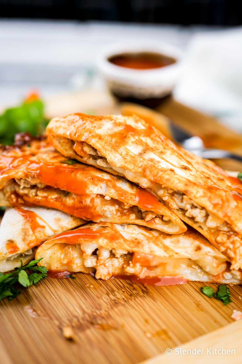 Easy buffalo chicken quesadilla stacked on top of each other.