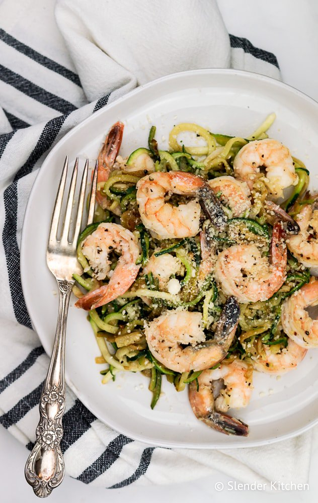 Weight Watchers Pesto Shrimp with Zucchini Noodles on a white linen.
