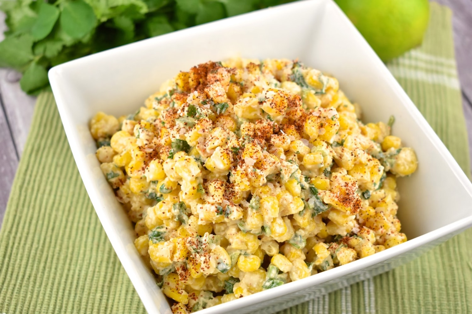 Weight Watchers Mexican Street Corn Salad on a wooden background.