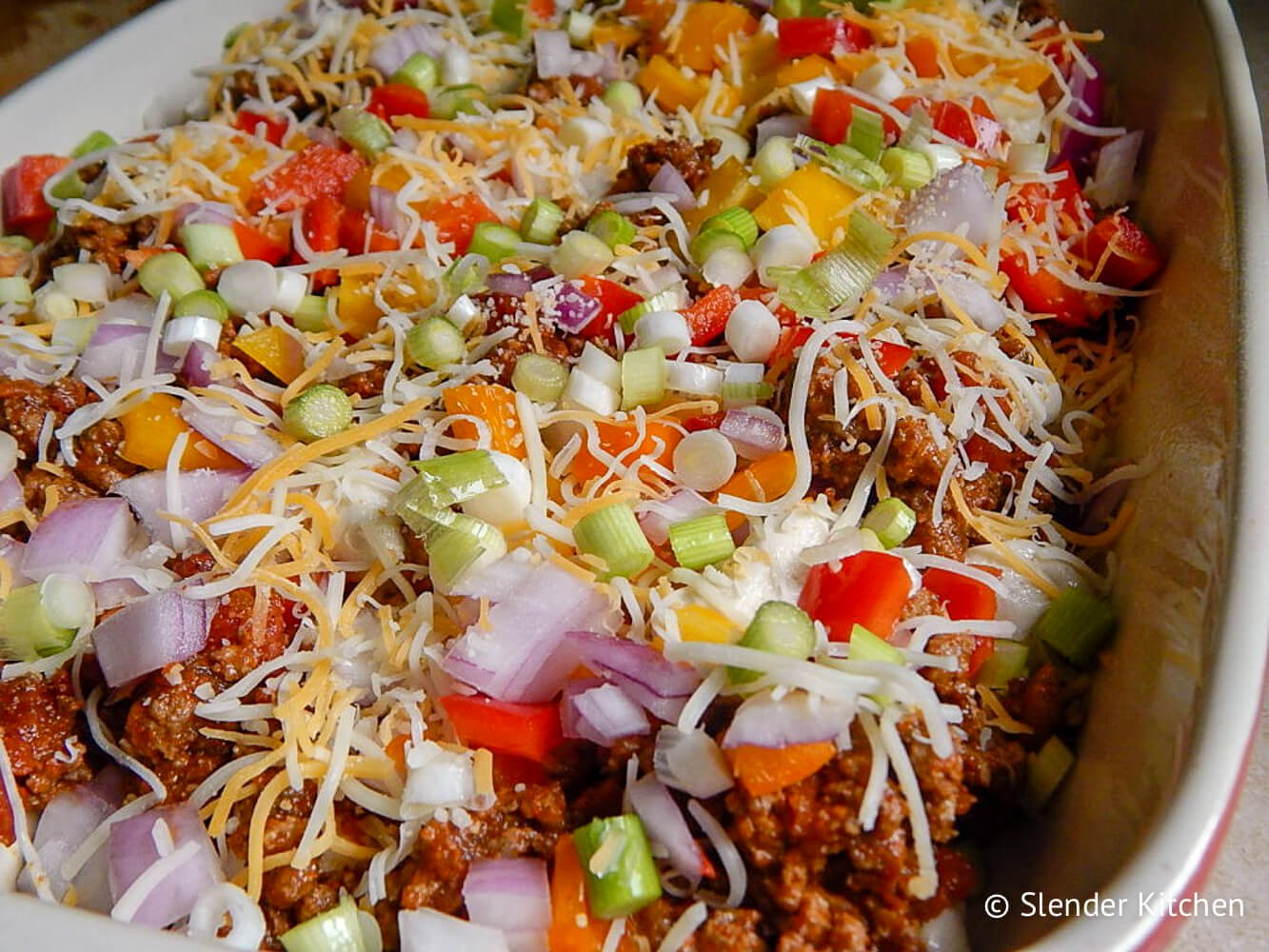 Taco Bubble Up casserole in a baking dish before going in the oven