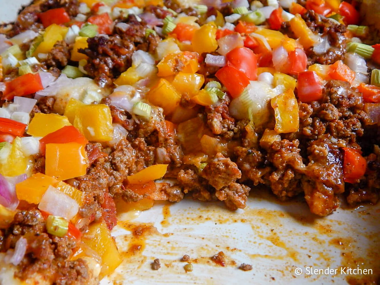 Cooked Taco Bubble Up from the side so you can see the layer of biscuit, meat, veggies, and cheese.