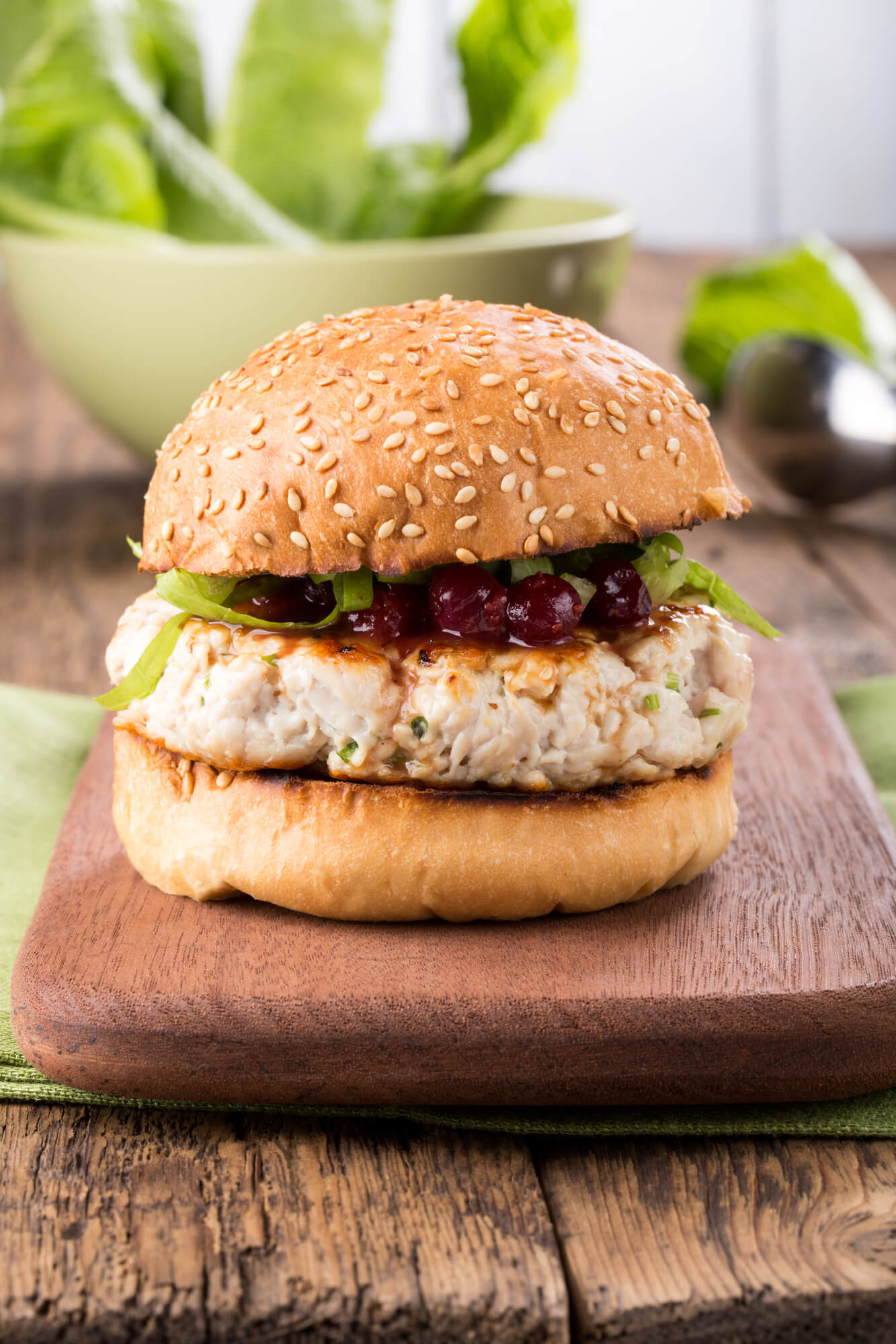 Chicken and zucchini burgers with cranberry sauce on wheat bread.